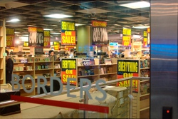 View of the sales signs through the front glass of the store