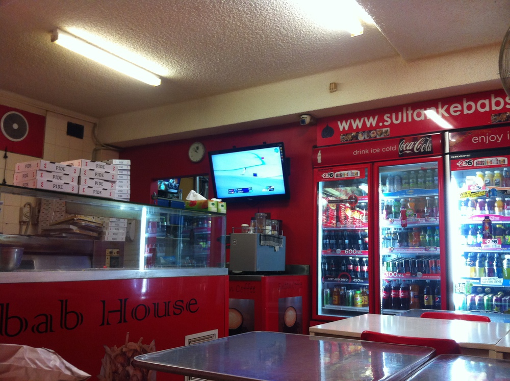 TV inside a kebab restaurant in Sydney showing Winter Olympic skiing