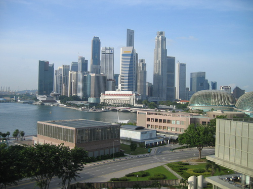 The Singapore skyline from the Oriental Hotel across the bay.