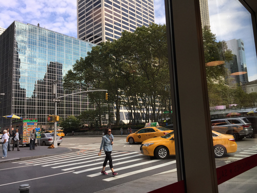 Beautiful mid-morning view of Bryant Park and the street outside this coffee shop