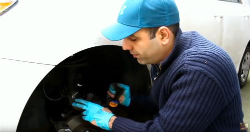 Medhi adjusts caliper on his car