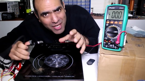 Medhi demonstrating induction cookers, with a MT-5211 pictured