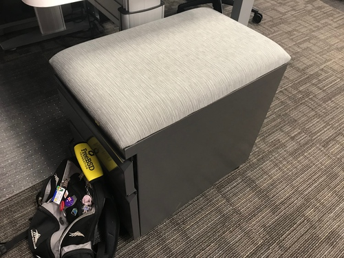 Photo of a filing cabinet with a squishy cushion attached