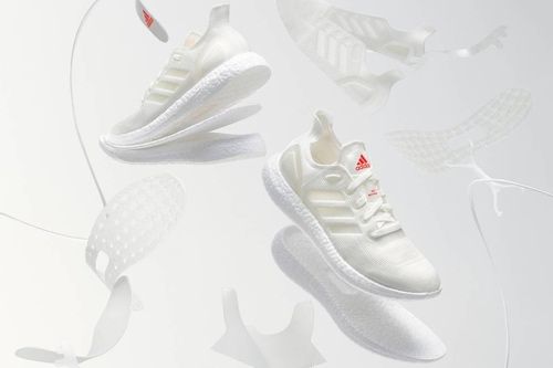 Picture of the recyclable Adidas shoes with different parts of the shoe separated.