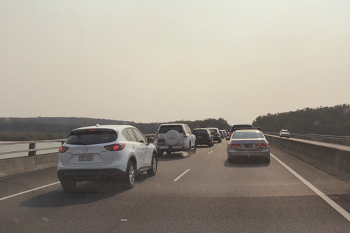 Photo of the freeway bridge across the Karuah River, showing bumper-to-bumper traffc barely moving.