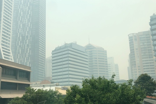 The same view, obscured by haze and smoke.