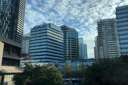 Skyline of Chatswood, showing scattered clouds on a blue sky.