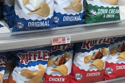 Shelf in Isetan showing Original, Sour Cream and Onion, and Chicken flavoured Ruffles