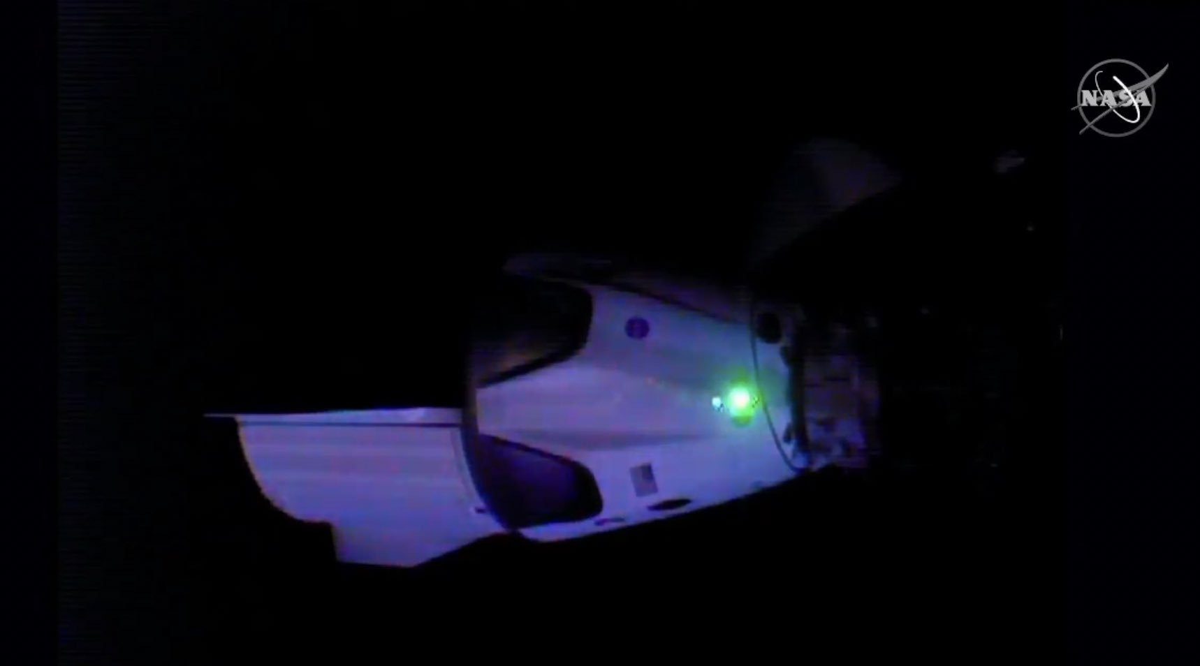 Screenshot from the NASA feed showing the SpaceX Crew Dragon docking with the International Space Station.