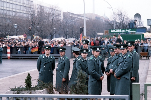 Police personnel (NCOs and enlisted men) of the East German Volkspolizei wait for the official opening of the Brandenburg Gate, December 22nd 1989.