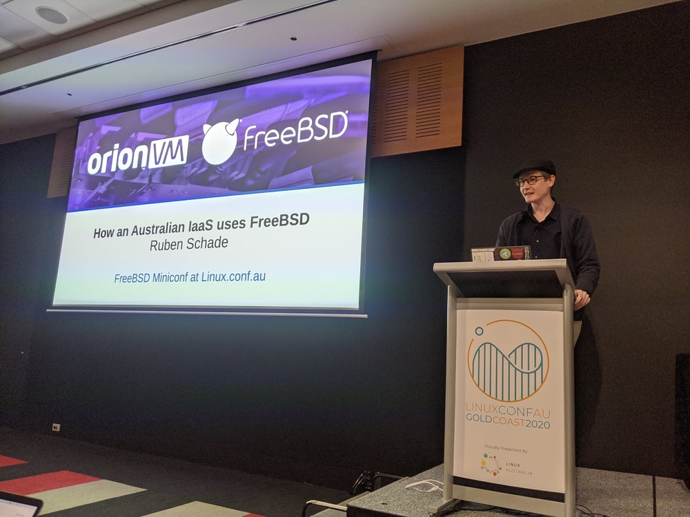 Me awkwardly presenting my talk on FreeBSD at OrionVM