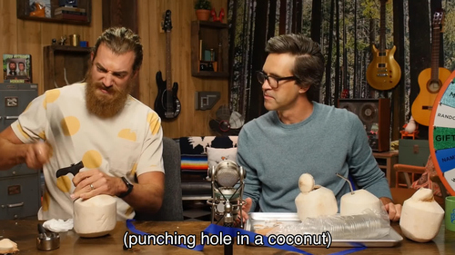 (Rhett punching a hole in a coconut).