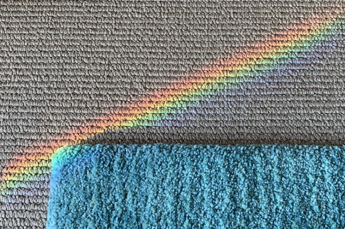 View of a small rainbow streaking across our carpets