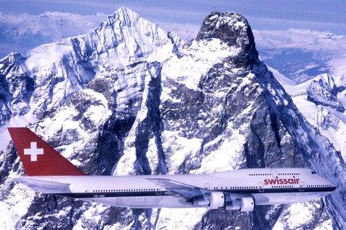 Photo of a Swissair 747-300 against an alpine landscape