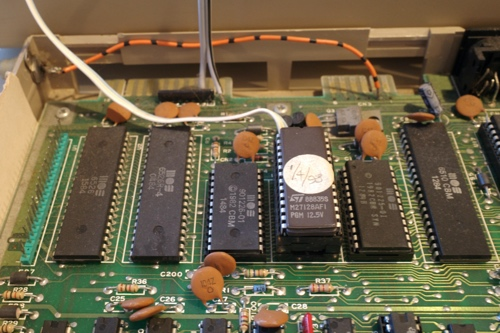 Final photo showing the JiffyDOS IC on top of the standard Commodore ROM, and wires going to the RCA jack.