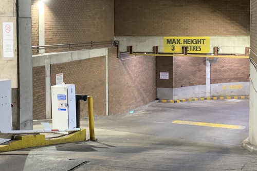 Photo of a carpark entrance with the above-described sign.