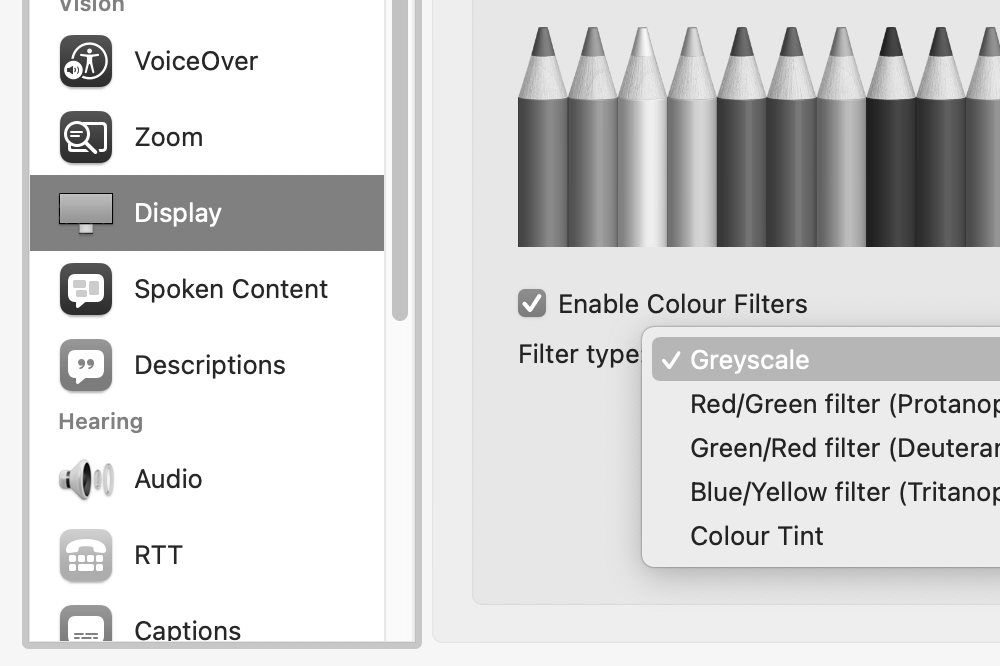 Screenshot of the macOS Accessibility preference pane, showing greyscale colour mode selected