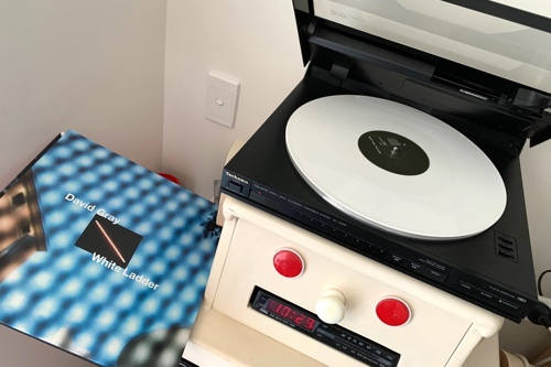 Photo showing the White Ladder LP playing in the aforementioned turntable, with the sleeve on the left.