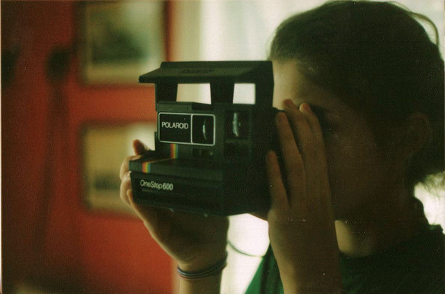 Hipster holding a Polaroid