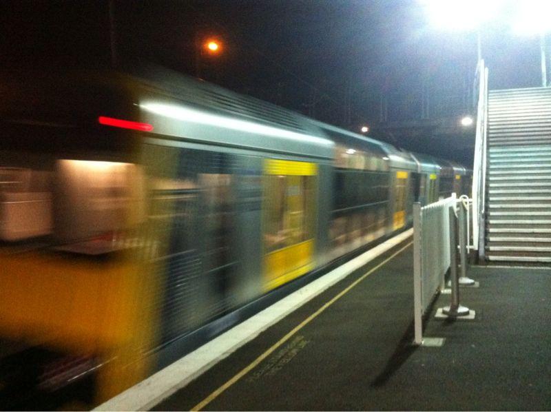 Sydney Tangara train speeding past