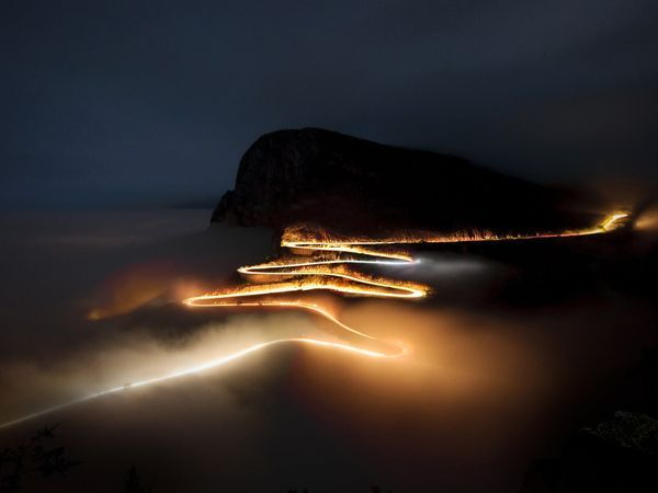Spooky photo of a winding road that appears to be on fire