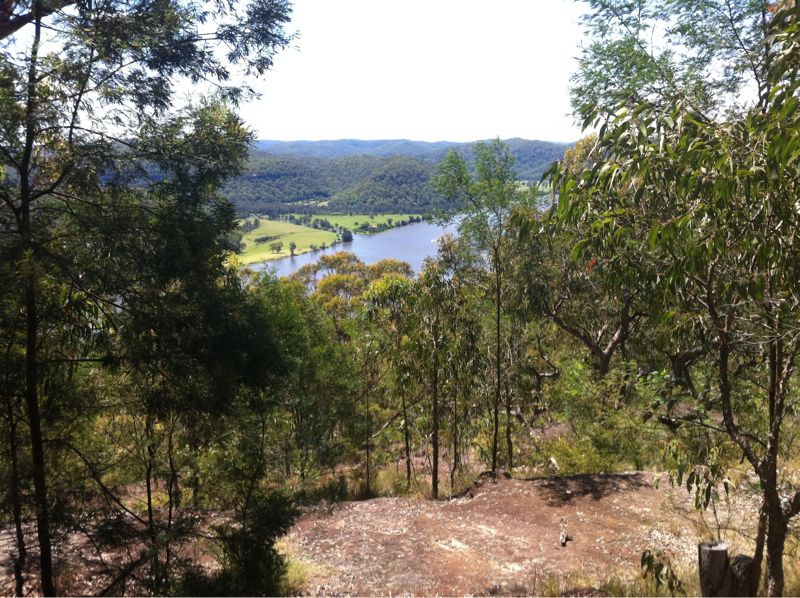 Photo of Hawkins Lookout, looking out (as the name implies) over the valley with trees and a river