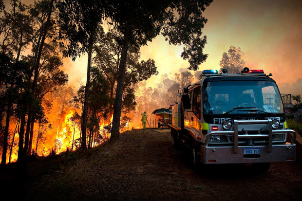 Photo of a fire truck fighting a huge blaze near Perth