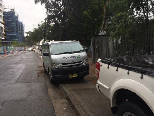 Toyota Plastix van parked on a footpath.