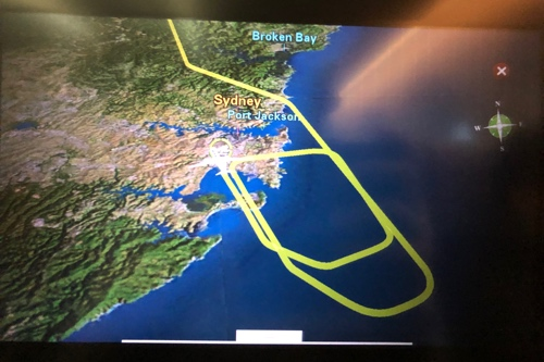 According to the awesome flight tracker in the in-flight entertainment system, we banked sharply to the right, and went back out over the Pacific to circle back and re-attempt.