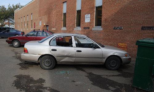 Broken car window photo by Myke Waddy, releases it into the public domain.