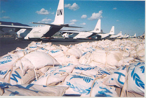 United Nations C-130 Hercules transports deliver food to the Rumbak region of Sudan