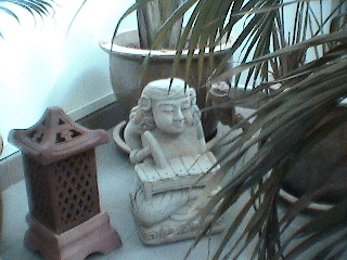 Photo of a soapstone sculpture on our balcony in Singapore taken in 2001.