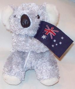 Soft toy koala holding an Australian flag.