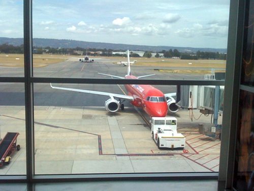 A Virgin Blue 737 at Adelaide Airport with the city in the distance