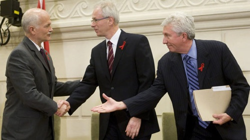 NDP Leader Jack Layton, left, shakes hands with Liberal Leader Stéphane Dion, centre, and Bloc Québécois Leader Gilles Duceppe on Monday after signing a coalition agreement on Parliament Hill.
