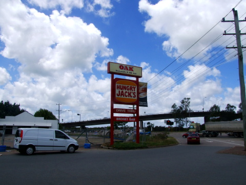 A photo I took of the legendary Oak and Hungry Jacks rest stop sign on the highway between Sydney and Taree.