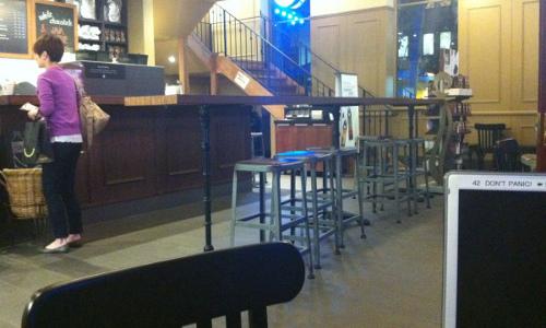 Photo of the inside of the Starbucks near Haymarket in Sydney.