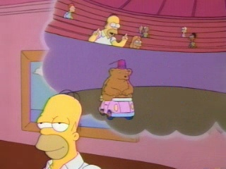 Screenshot from the 'Marge on a Lamb' episode of The Simpsons, showing Homer thinking of a bear riding around in a tiny car... with a hat!