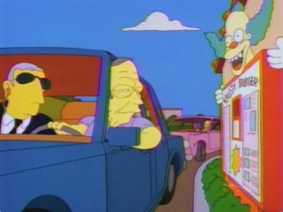 George Bush Sr. at a Krusty drive-through window in The Simspsons.